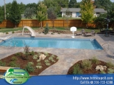 landscaping-beds-create-softness-in-pool-area