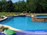 Custom Gunite Pool with Swim out and Spill over spa