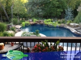 Custom Built Vinyl pool with Fire Features, Basketball Goal, and Stamped concrete